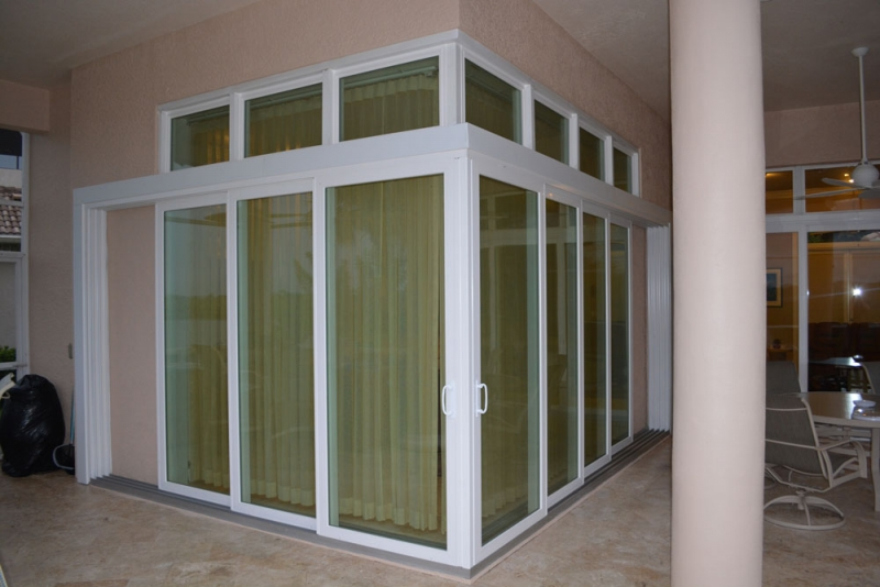 Aluminum sliding doors rollshield hurricane protection for Non sliding patio doors