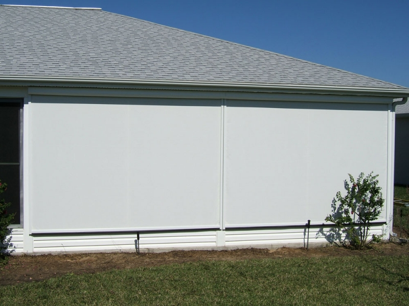 Solarroll motorized garage door screens for Roll down garage door screen