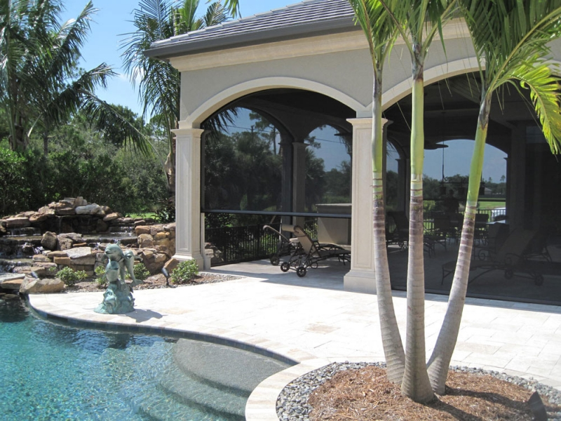 Retractable screens rollshield hurricane protection for Motorized retractable screens for porches