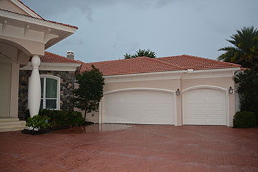 Garage doors rollshield hurricane and storm protection for Garage door wind code ratings