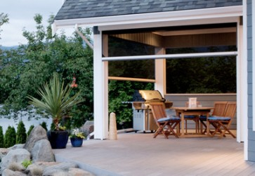 Retractable screens rollshield hurricane and storm for Retractable screen porch systems